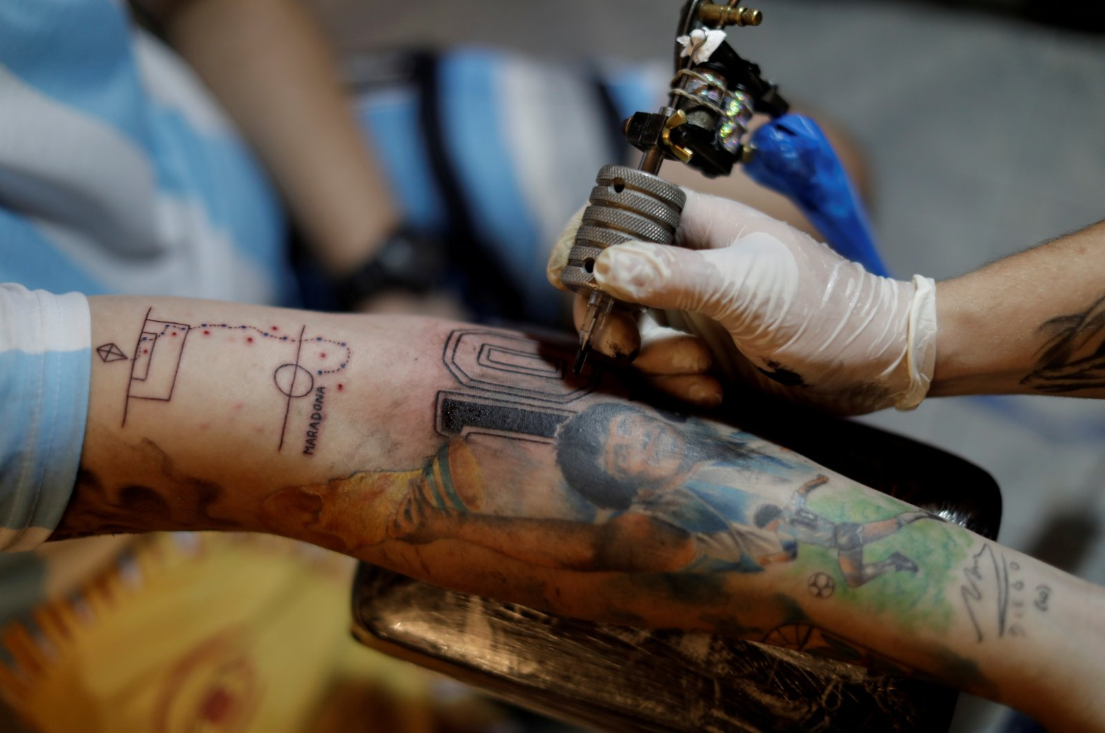 Maximiliano Fernando, a fan, has an image of number 10 related to Maradona's former shirt number tattooed on his arm, in Buenos Aires, Argentina, Nov. 28, 2020. (REUTERS PHOTO)