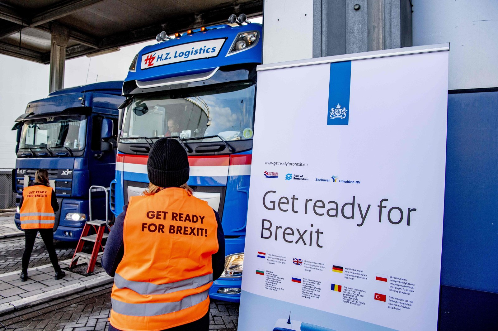 Flyers are distributed, as part of the Get Ready For Brexit campaign, to truck drivers at the terminal of a ferry operator in the port of Rotterdam on Dec. 1, 2020. (AFP Photo)