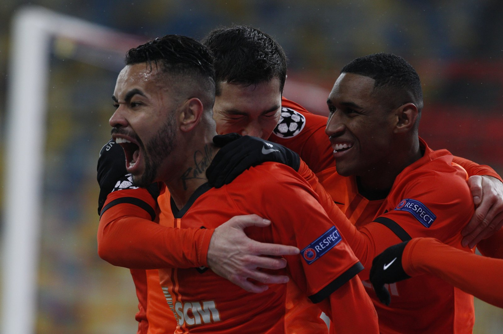Shakhtar Donetsk's Dentinho shares his joy with teammates after scoring their first goal during the Champions League, Group B, soccer match between Shakhtar Donetsk and Real Madrid at the Olimpiyskiy Stadium in Kyiv, Ukraine, Dec. 1, 2020. (AA Photo)