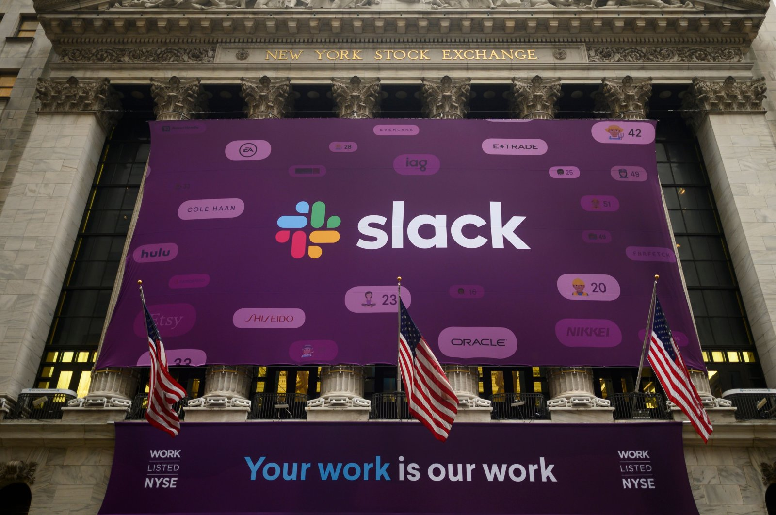 In this file photo taken on June 20, 2019, the logo of Slack Technologies Inc. adorns the New York Stock Exchange after the company's public offering. (AFP Photo)