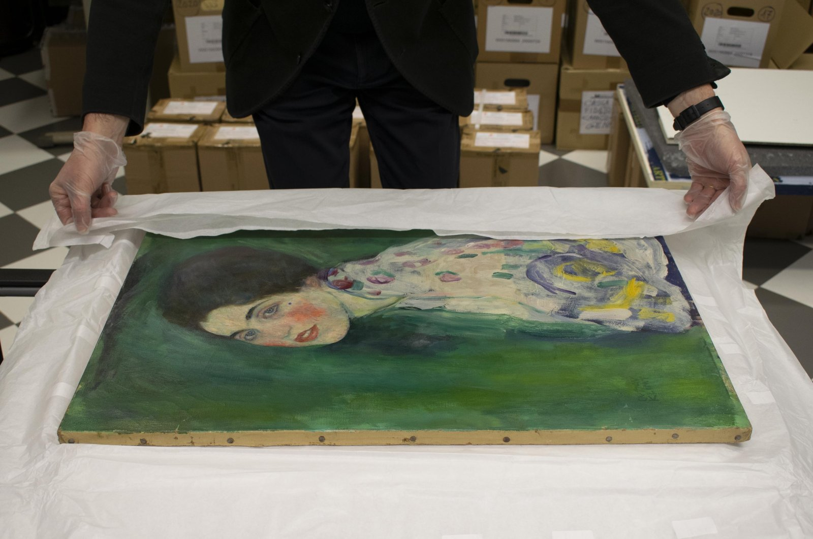 "The Ricci Oddi Gallery unpacks the rediscovered ""Portrait of a Lady"" by Austrian art nouveau master Gustav Klimt, in Piacenza, Italy, Nov. 28, 2020. (DPA Photo)"