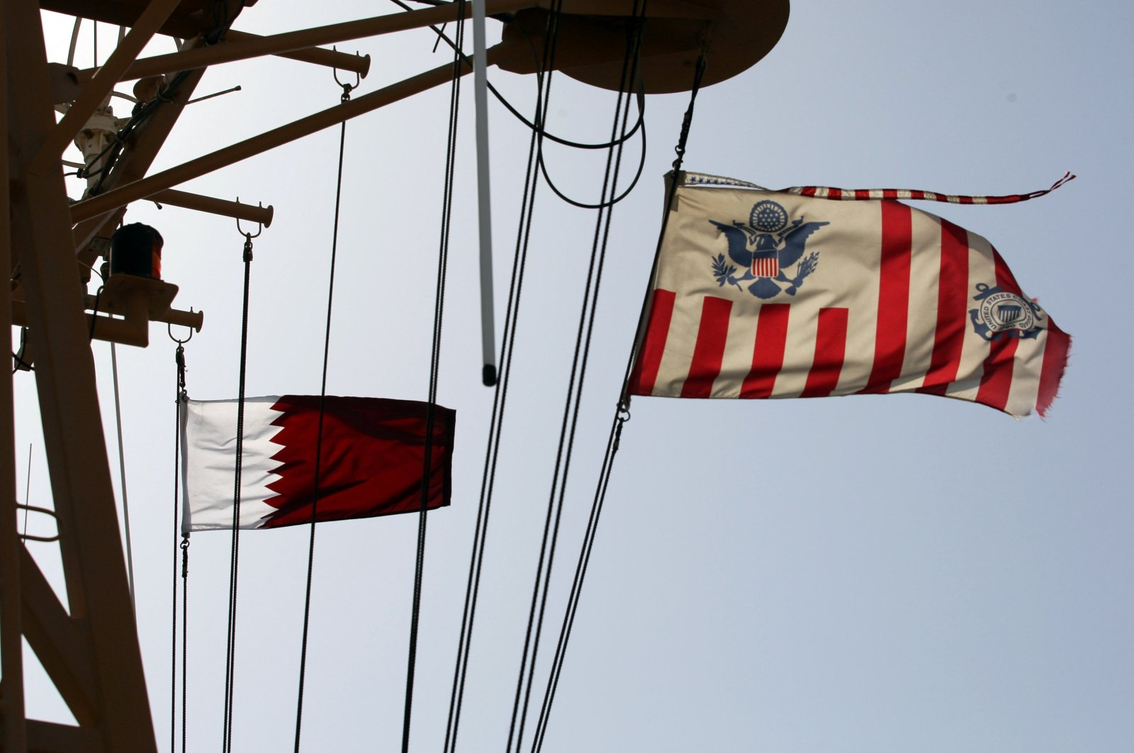 Qatari and U.S. Coast Guard flags flutter during a joint naval exercise by American and Qatari troops in the Arabian Gulf, Qatar, June 16, 2017. (Reuters Photo)