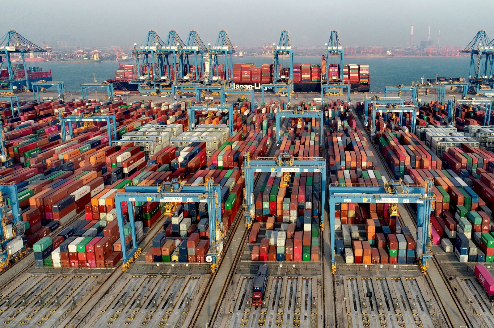 Shipping containers sit stacked at Asia's first fully automated container terminal of Qingdao Port in the Qingdao Area of China (Shandong) Pilot Free Trade Zone (FTZ) in Qingdao, Shandong province, China, Dec. 1, 2020. (Getty Images)