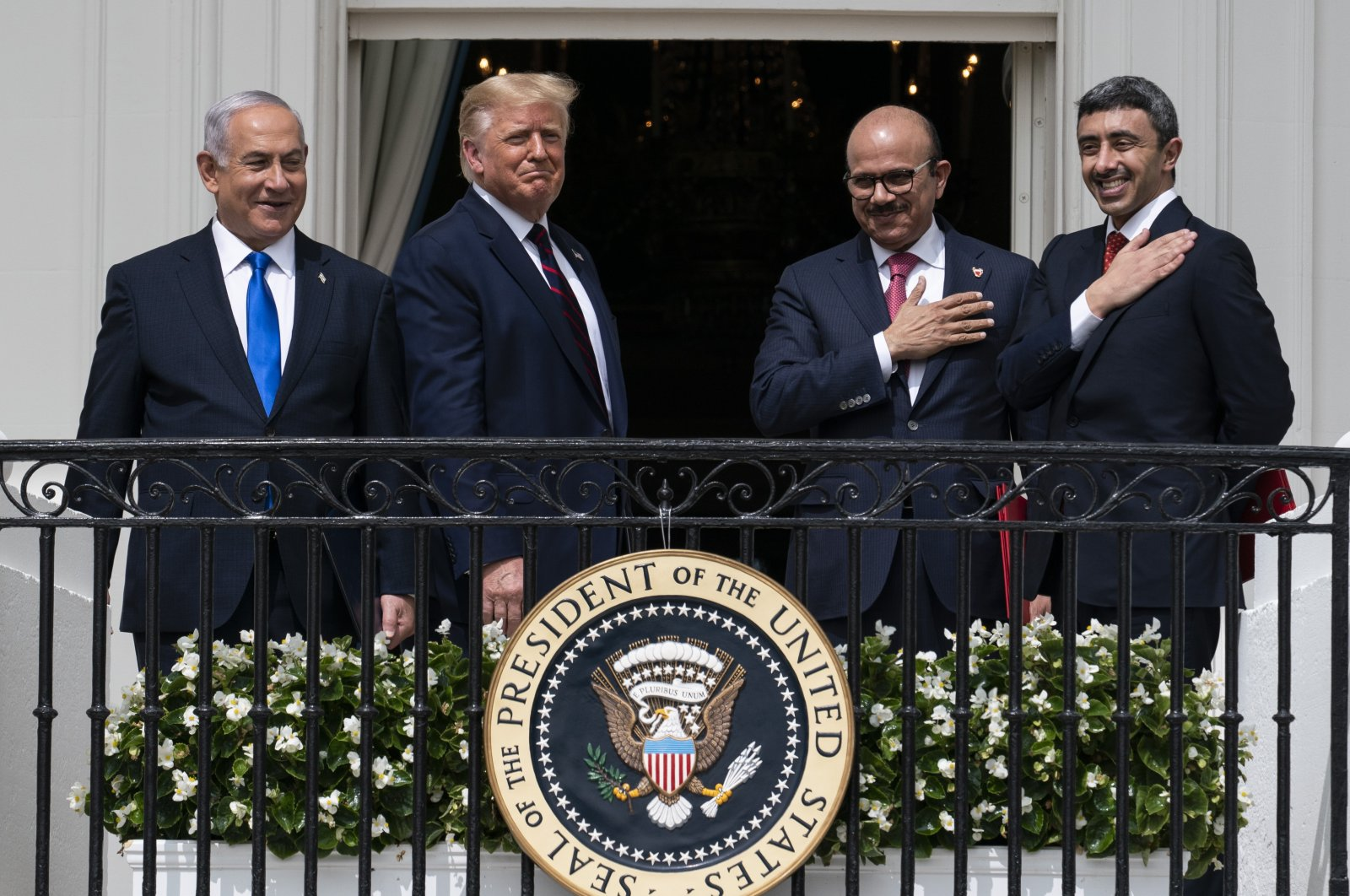 (L to R) Israeli Prime Minister Benjamin Netanyahu, U.S. President Donald Trump, Bahrain's Foreign Minister Khalid bin Ahmed al-Khalifa and United Arab Emirates' Foreign Minister Abdullah bin Zayed al-Nahyan react on the Blue Room Balcony after signing the Abraham Accords during a ceremony on the South Lawn of the White House in Washington, D.C., U.S., Sept. 15, 2020. (AP Photo)