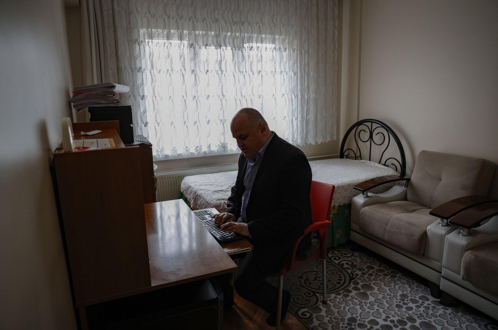 Ceyhun Demir sits at his home in the capital Ankara, Turkey, Dec. 2, 2020. (AA Photo)