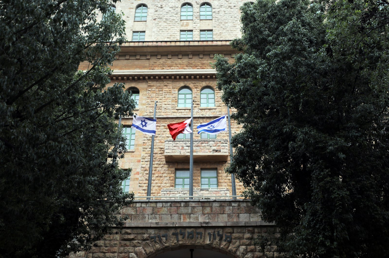 The national flags of Israel and Bahrain flutter at the entrance of the King David Hotel in Jerusalem, Nov. 26, 2020. (Reuters Photo)
