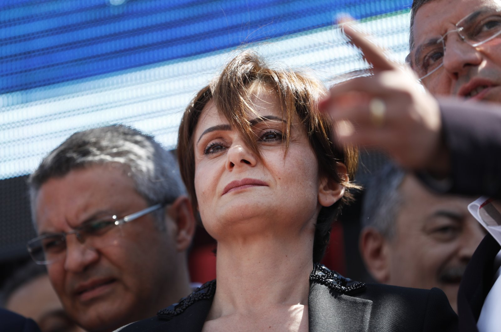 Canan Kaftancıoğlu, Turkey's opposition Republican People's Party (CHP) Istanbul provincial chairwoman is surrounded by supporters outside a court in Istanbul, Thursday, July 18, 2019. (AP File Photo)