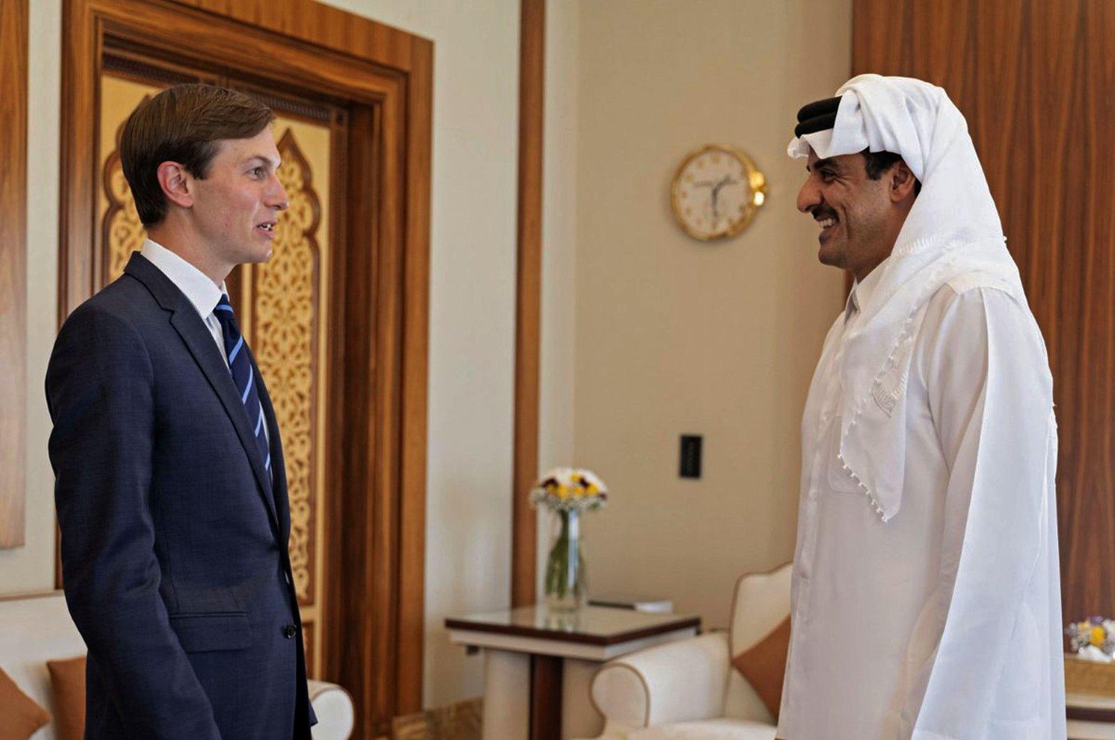 Senior adviser to the U.S. president Jared Kushner (L) meets with Qatar's ruler Emir Sheikh Tamim bin Hamad Al Thani in this handout photo released by the Qatar News Agency (QNA), Doha, Qatar, Sept. 2, 2020. (Qatar News Agency via AFP)