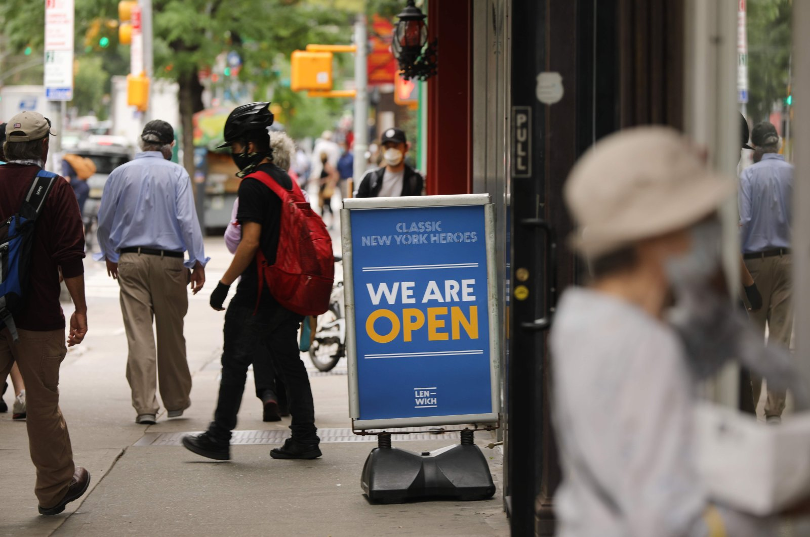 People walk through Manhattan as the city prepares to enter stage two of reopening in New York City, June 18, 2020. (AFP Photo)