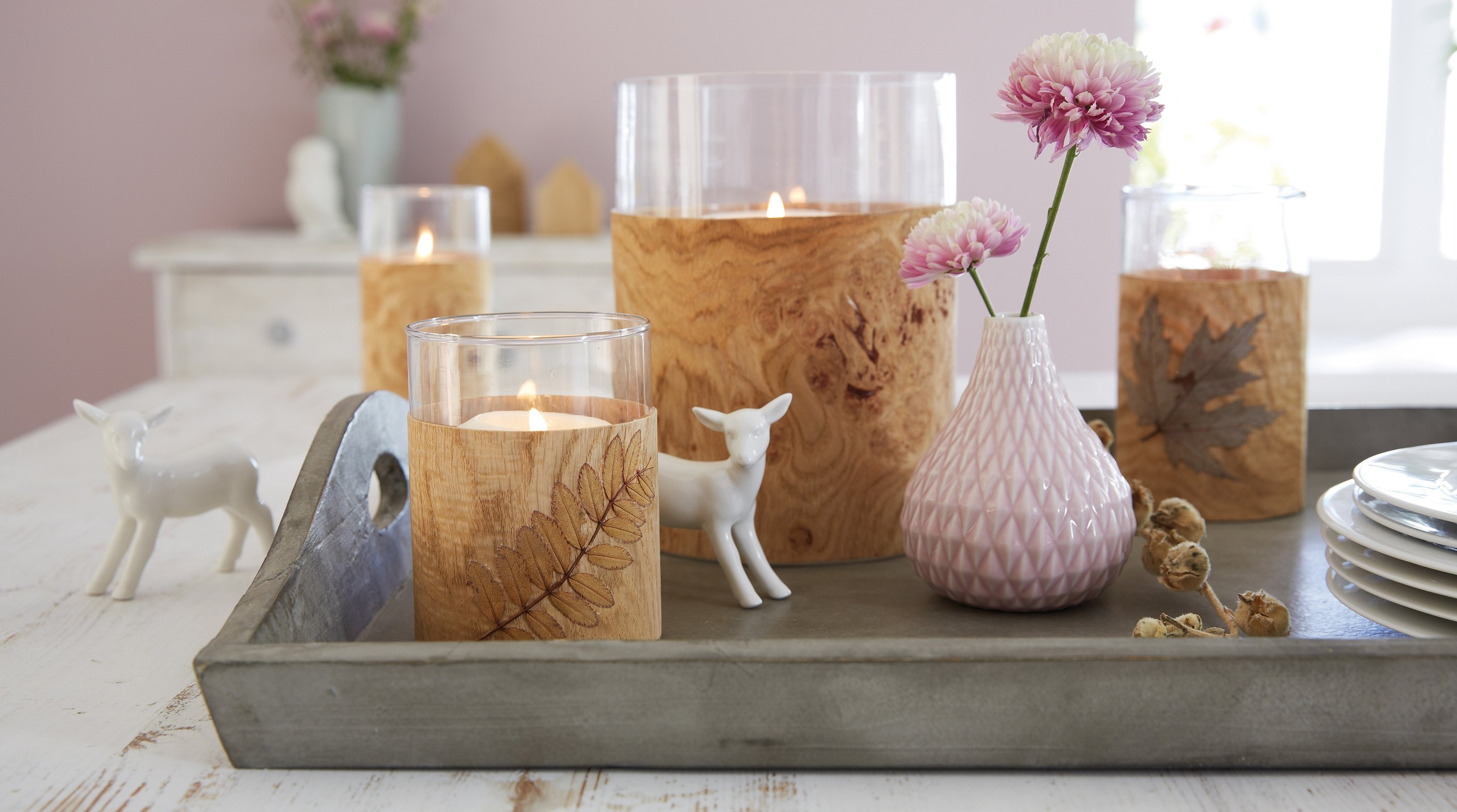 Tea lights with wood veneer are undeniably pretty and also pretty easy to make. (tesa/DPA Photo)