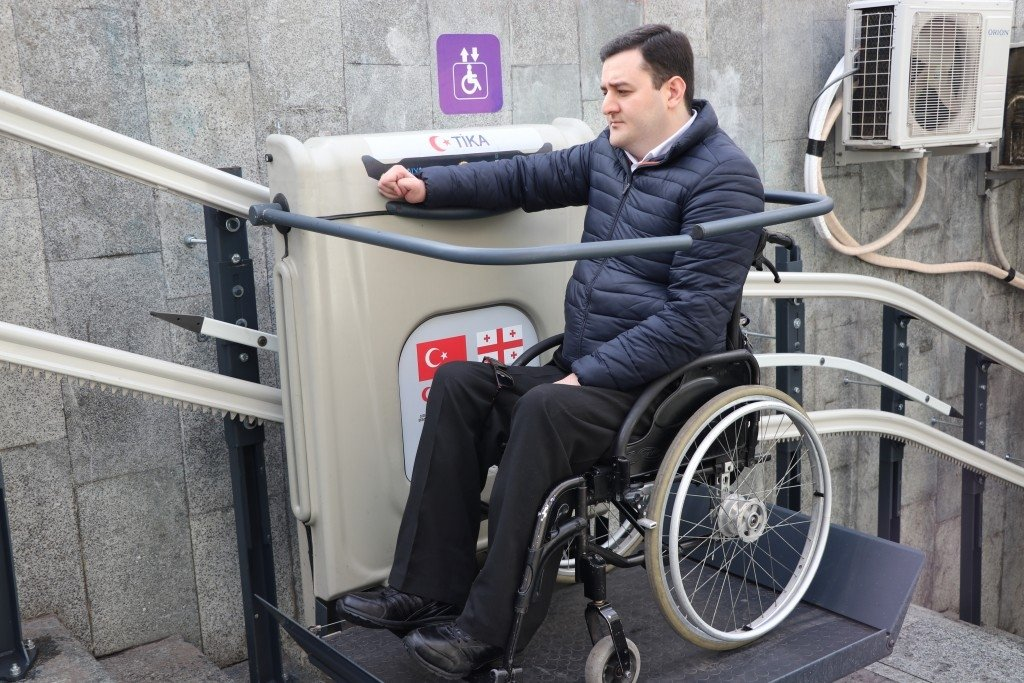 A wheelchair-bound man uses an elevator installed by the Turkish Cooperation and Coordination Agency (TIKA) in Tbilisi, Georgia, Feb. 3, 2020. (Courtesy of TIKA)