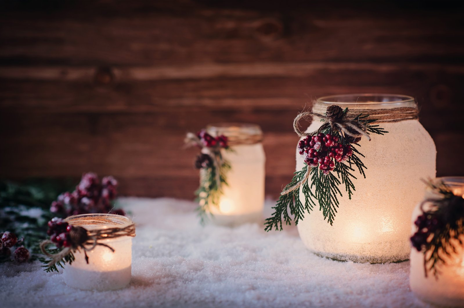 With some creativity and spray-on frost, you can create your own wintery frosty candles. (Shutterstock Photo)