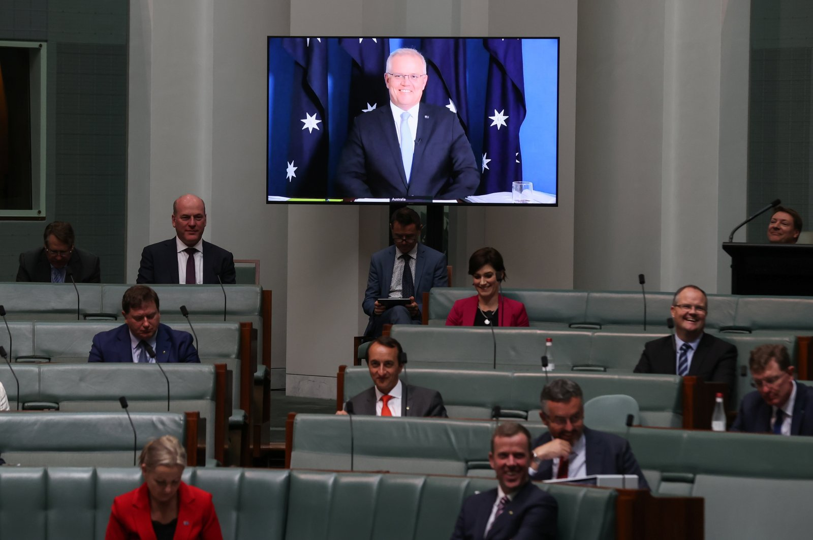 Australia's Prime Minister Scott Morrison appears via videoconference from his quarantine at the Lodge, during Question Time in the House of Representatives at Parliament House in Canberra, Australia, Nov. 30, 2020. (Reuters Photo)