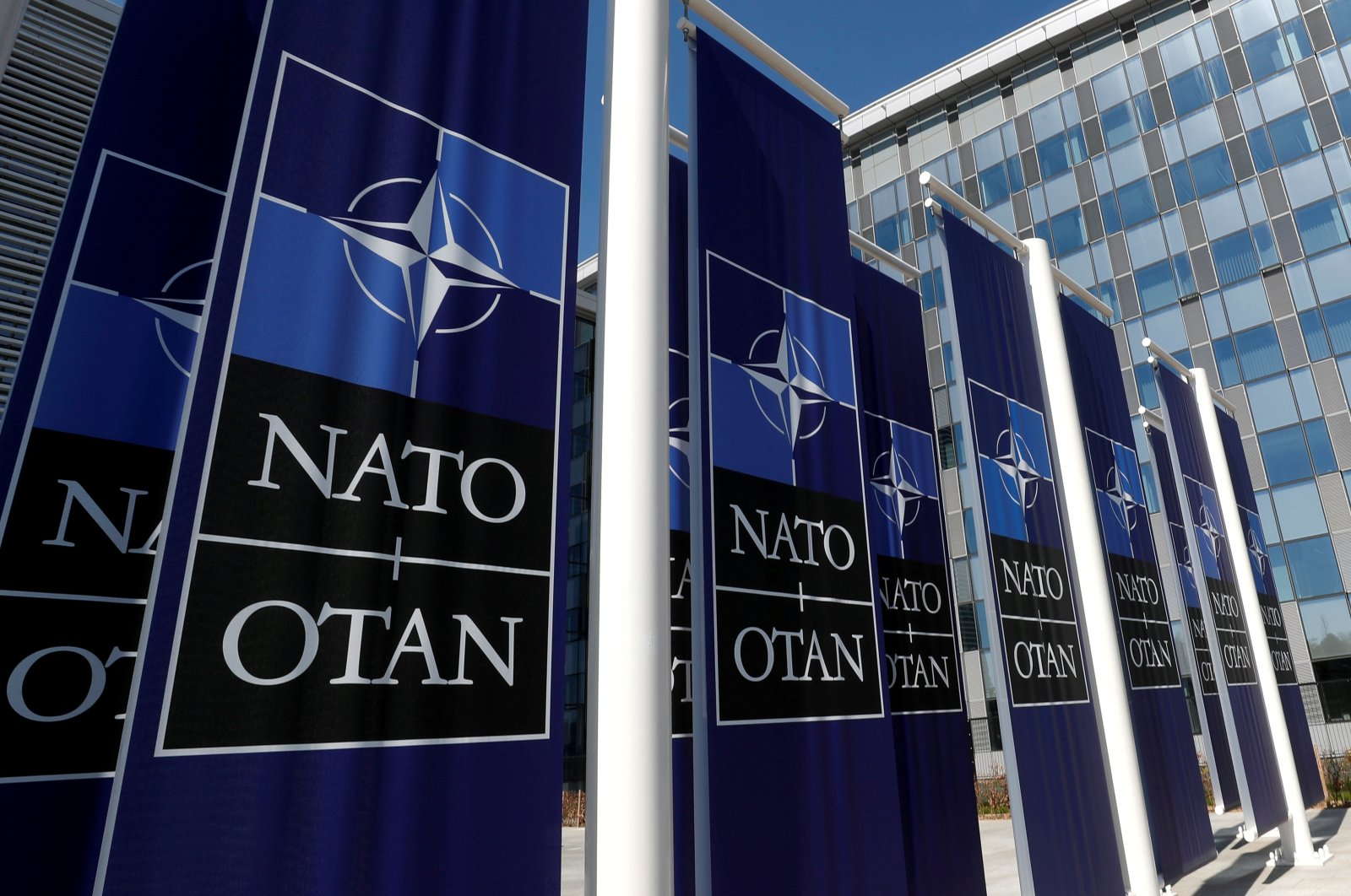 Banners displaying the NATO logo are placed at the entrance of the new NATO headquarters during the move to the new building, in Brussels, Belgium, April 19, 2018. (Reuters Photo)