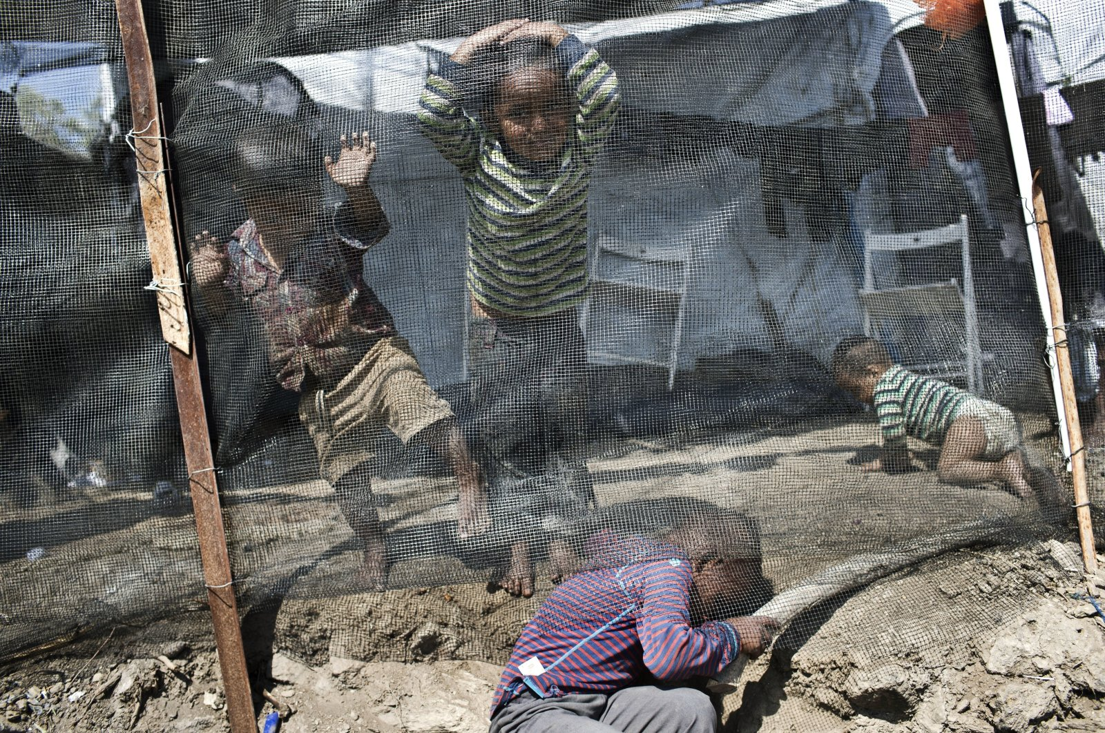 Children play inside the Moria refugee camp on the northeastern Aegean island of Lesbos, Greece, May 22, 2018. (AP Photo)
