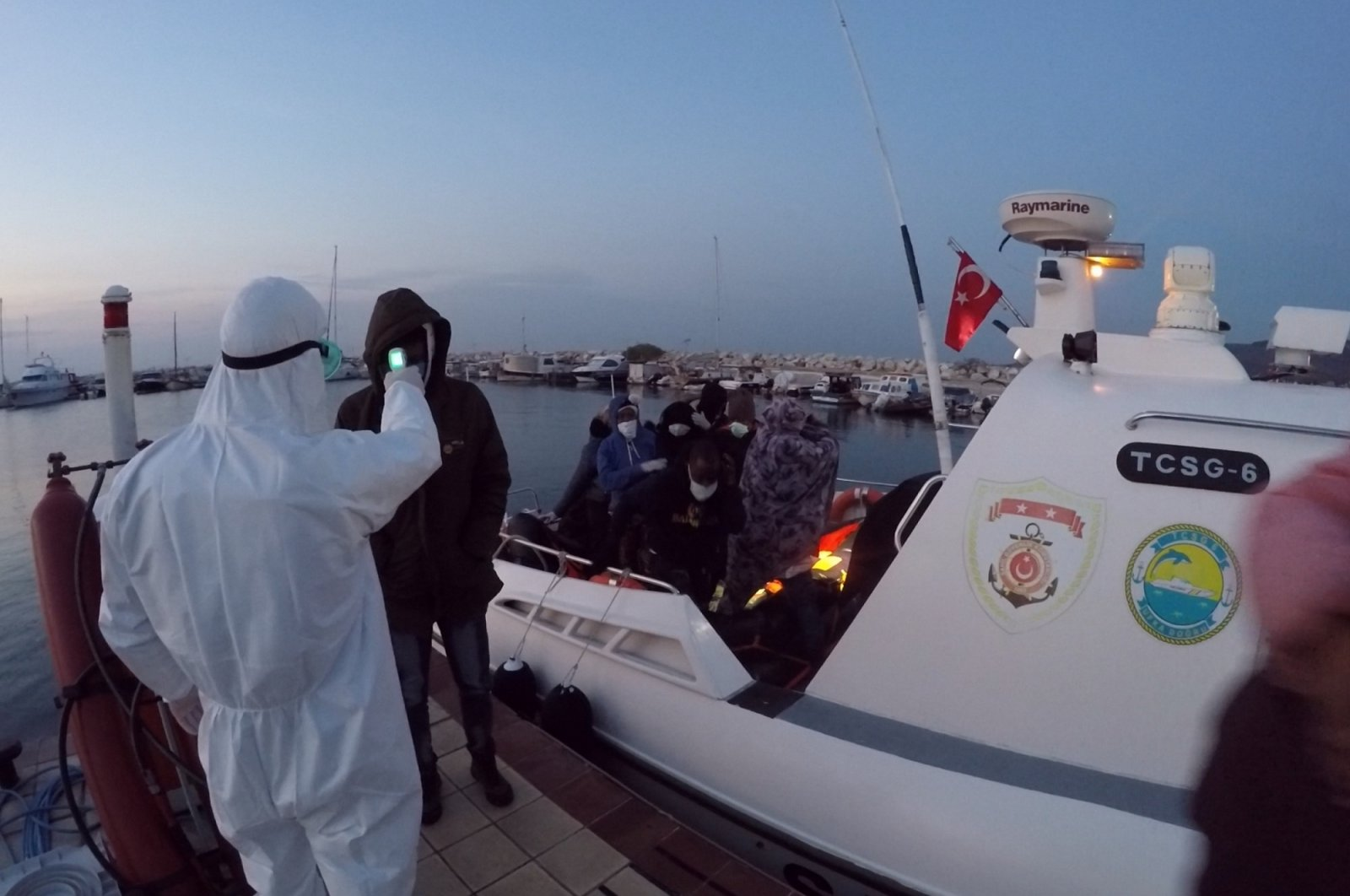 Turkey's Coast Guard Command rescues 80 irregular migrants trying to cross to the Greek island of Lesbos offshore western Çanakkale province's Ayvacık district, Turkey, Nov. 30, 2020. (AA Photo)