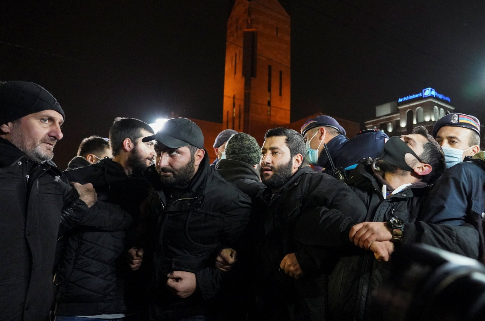 Participants attempt to block a street during an opposition rally to demand the resignation of Armenian Prime Minister Nikol Pashinian in Yerevan, Armenia, Dec. 3, 2020. (REUTERS Photo)