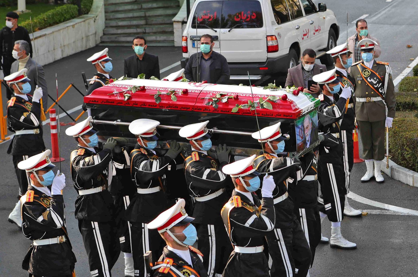 Members of Iranian forces carry the coffin of slain top nuclear scientist Mohsen Fakhrizadeh during his funeral ceremony in Iran's capital Tehran, Nov. 30, 2020. (AFP Photo)