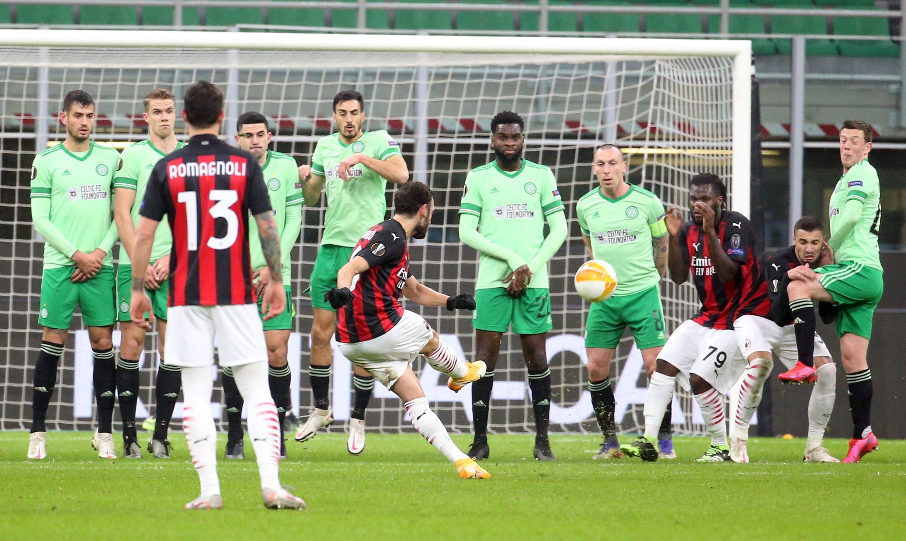 Milan's Hakan Çalhanoğlu (C) scores his team's first goal during the UEFA Europa League Group H soccer match against Celtic at Giuseppe Meazza stadium in Milan, Italy, Dec. 3, 2020. (EPA Photo)