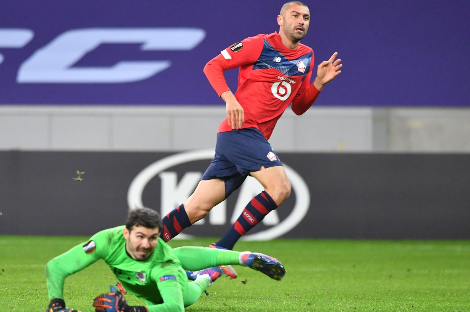 Lille forward Burak Yılmaz (R) watches his shot as he scores a goal during the UEFA Europa League Group H football match between Lille LOSC and Sparta Prague at the Pierre-Mauroy stadium in Villeneuve-d'Ascq, on the outskirts of Lille, northern France, Dec. 3, 2020. (AFP Photo)
