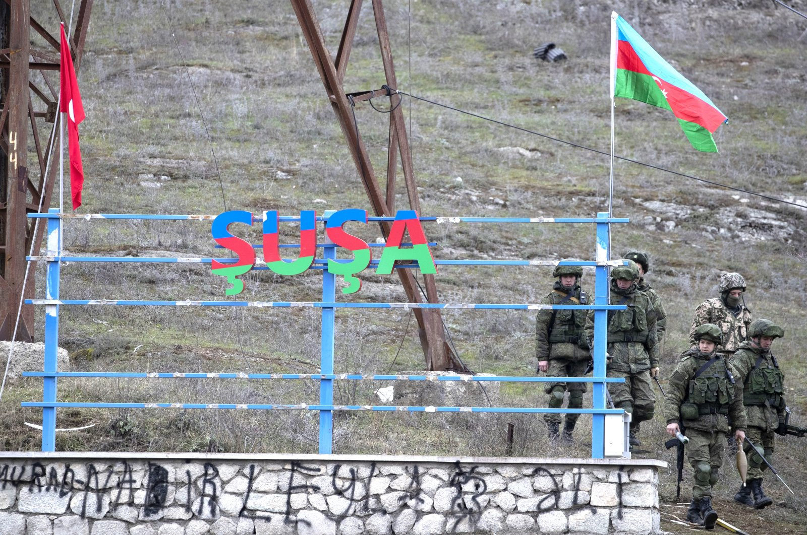 Russian peacekeepers and Azerbaijani servicepeople patrol the area at the entrance to the town of Shusha, Azerbaijan, Nov. 26, 2020. (Photo by Getty Images)