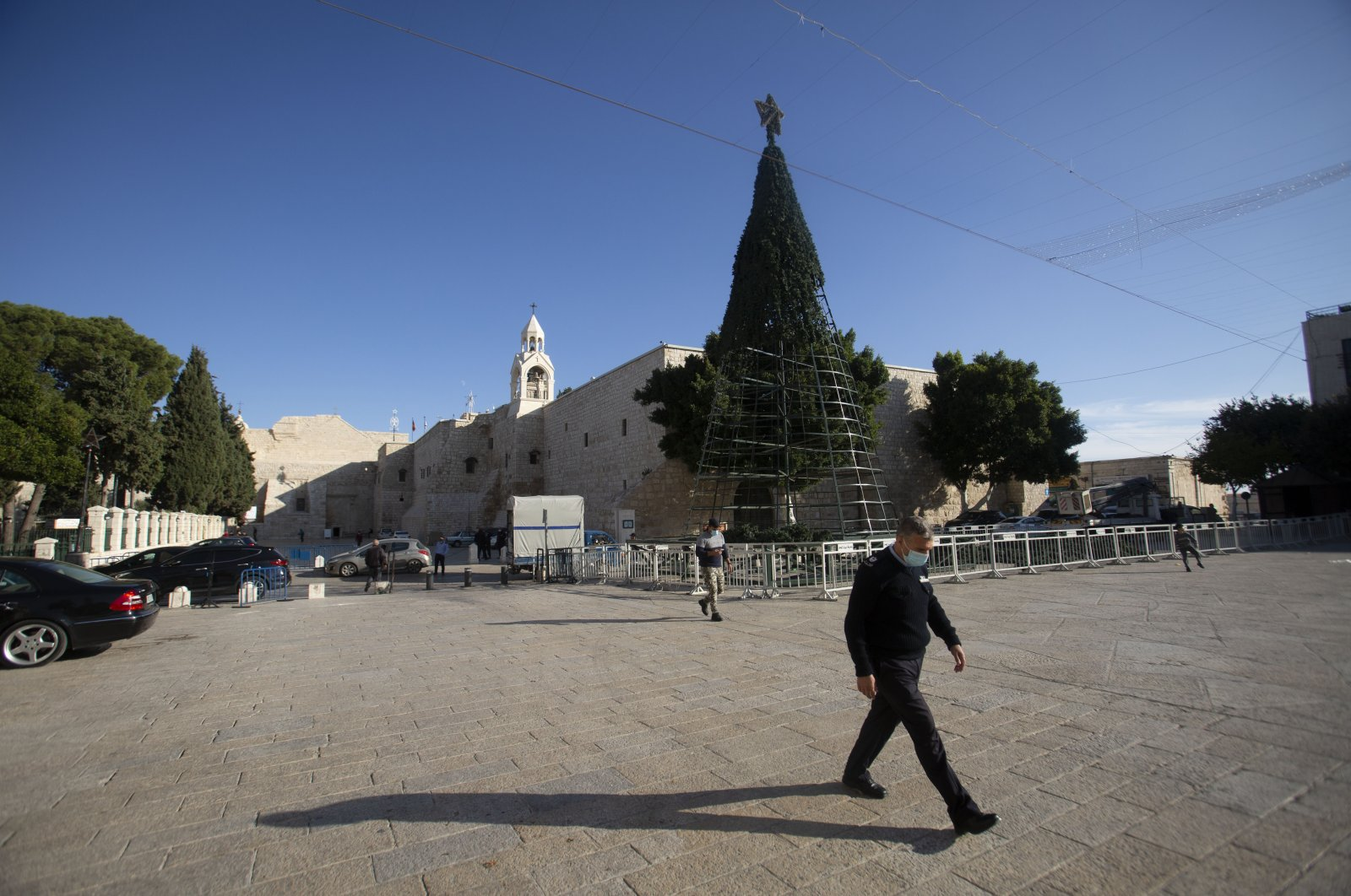 A man walks outside the Church of the Nativity, traditionally believed to be the birthplace of Jesus Christ, in the West Bank City of Bethlehem, Nov. 23, 2020. (AP Photo)