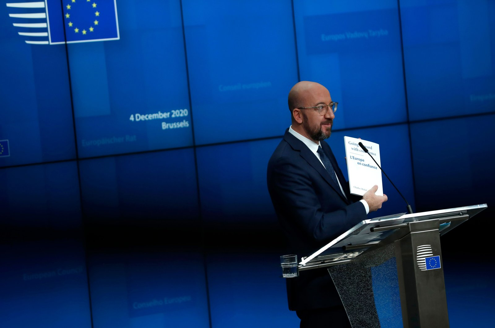 European Council President Charles Michel shows a document during a news conference marking his first year as president at the European Council headquarters in Brussels, Belgium, Dec. 4, 2020. (AFP Photo)