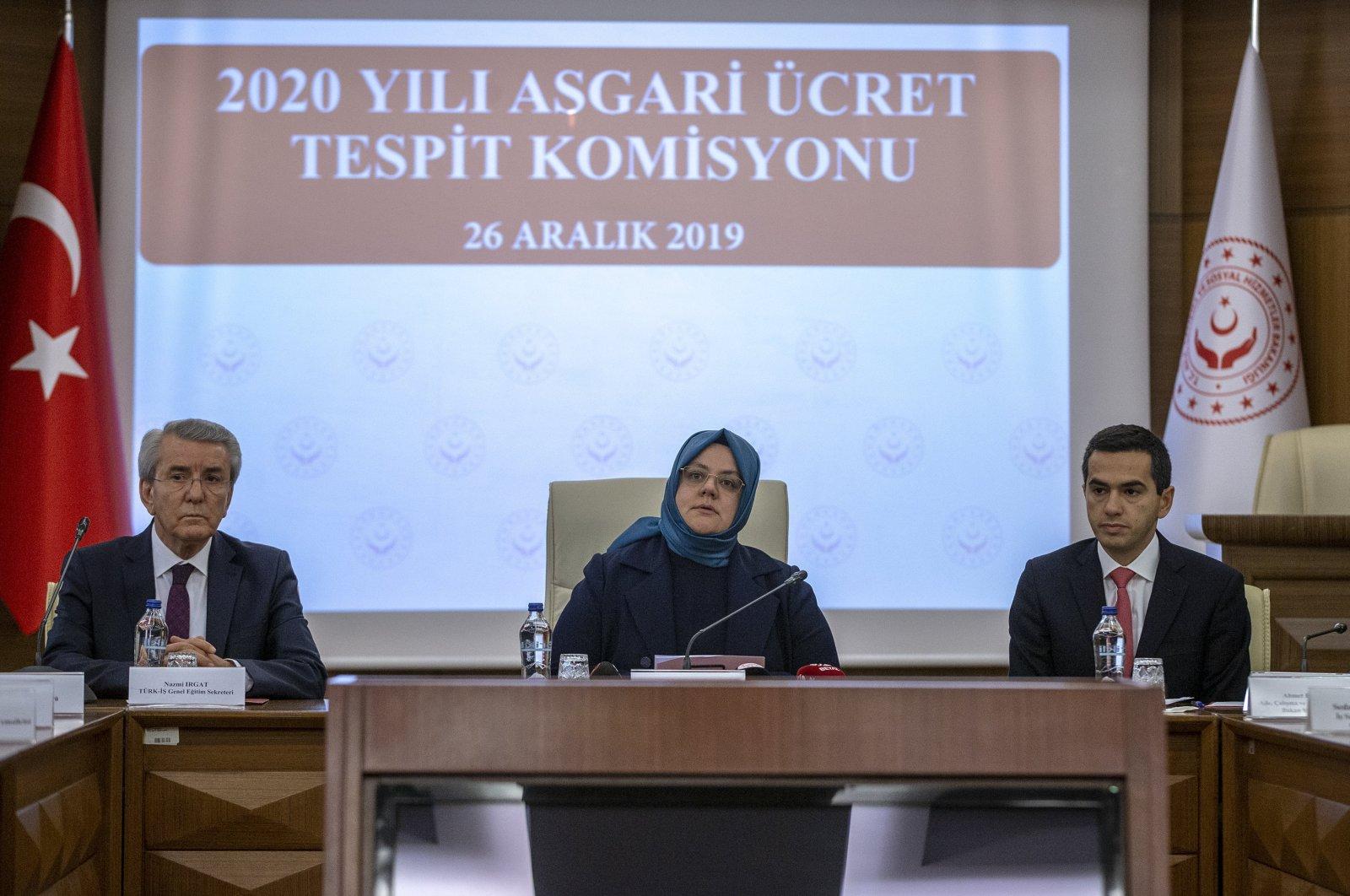 TÜRK-IŞ Secretary-General Nazmi Irgat (L), Minister of Family, Labor and Social Services Zehra Zümrüt Selçuk (C) and TISK head Özgür Burak Akkol (R) sit next to each other during a Minimum Wage Determination Commission meeting for the year 2020, Ankara, Turkey, Dec. 26, 2019. (AA Photo)