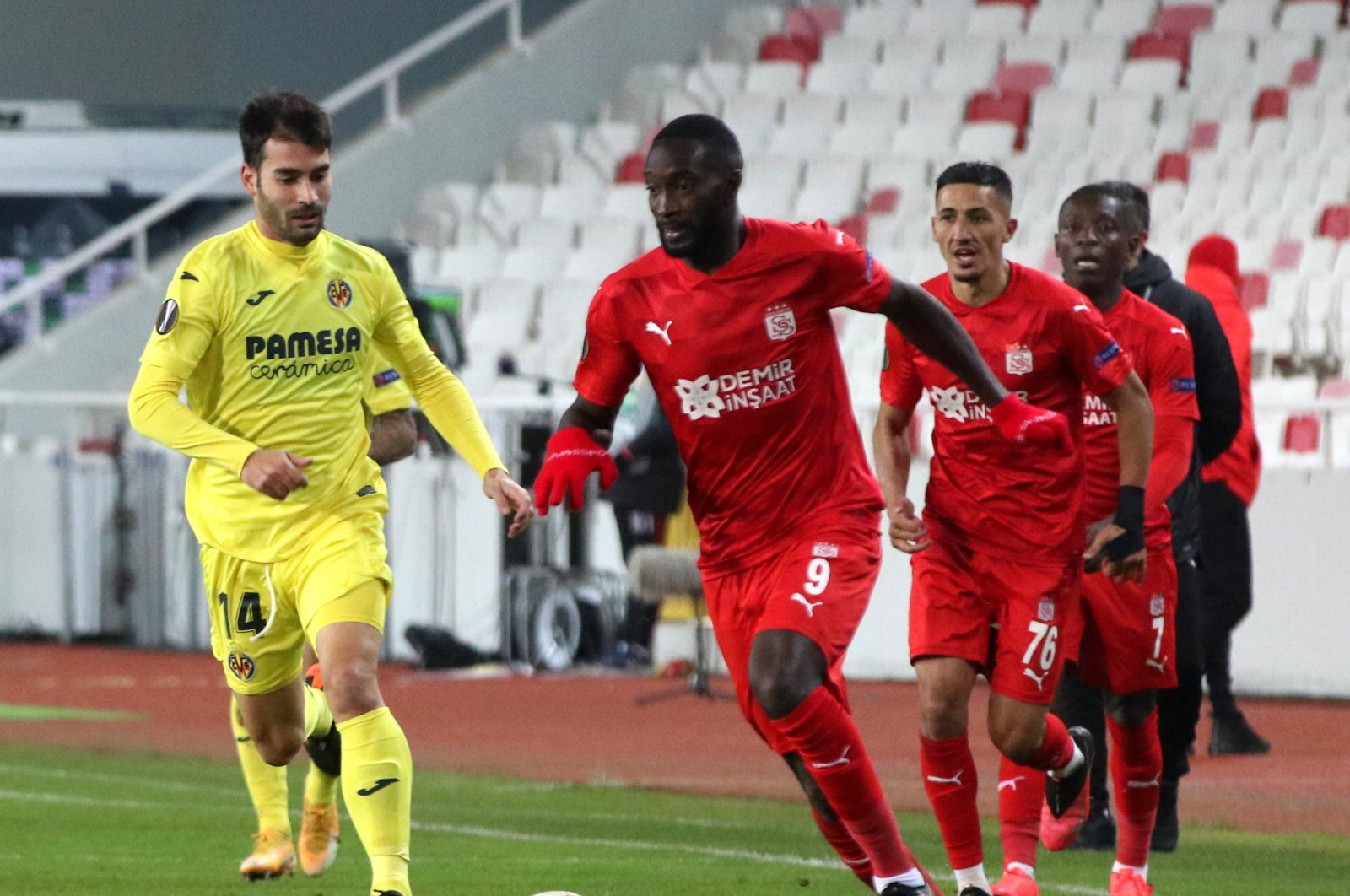 Sivasspor's Yatabare (R) in action against Villarreal's Trigueros during a match in Sivas, central Turkey, Dec. 3, 2020. (AA PHOTO)