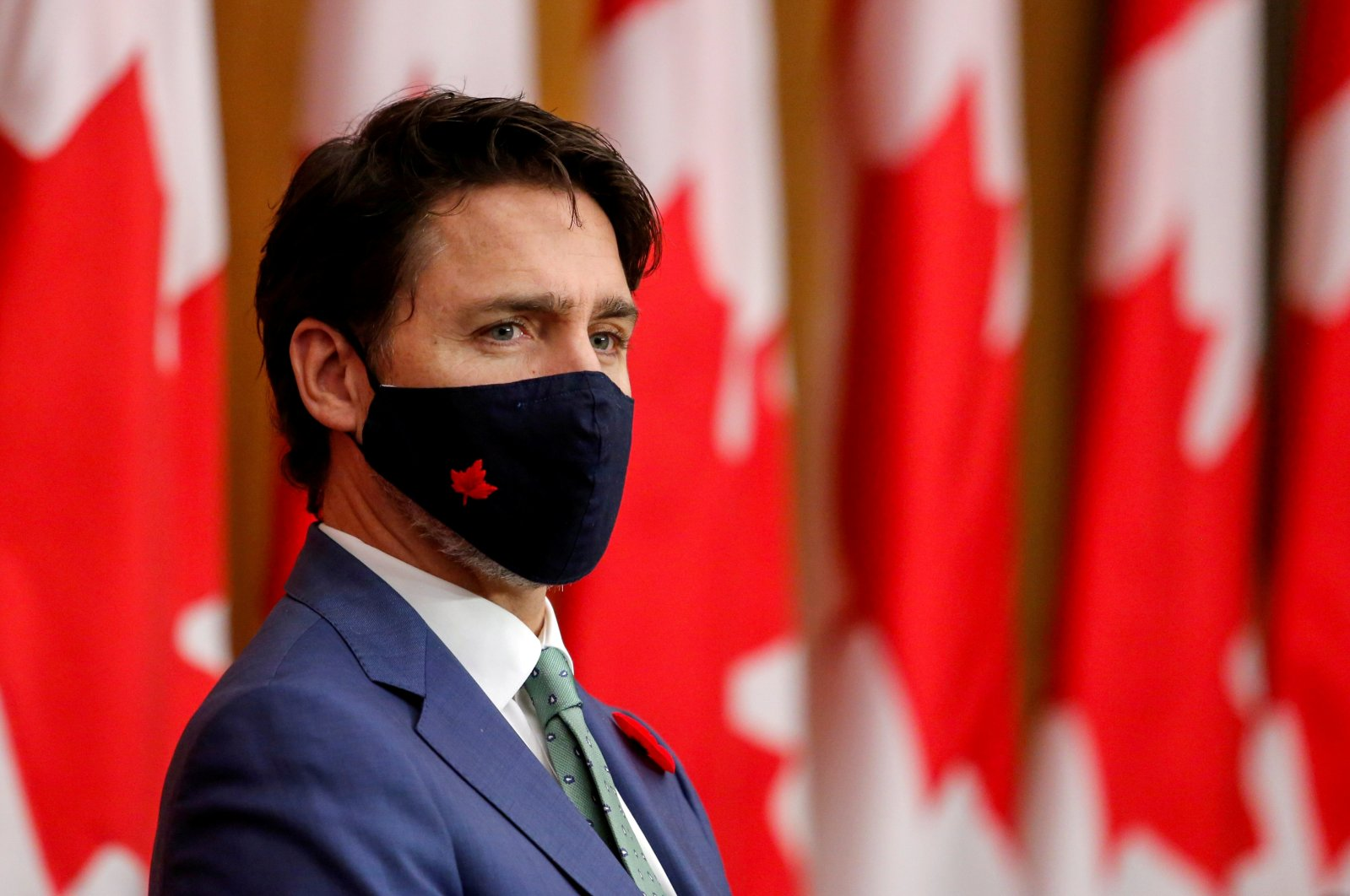 Canadian Prime Minister Justin Trudeau listens while wearing a mask at a news conference held to discuss the country's coronavirus disease response in Ottawa, Ontario, Canada, Nov. 6, 2020. (Reuters Photo)