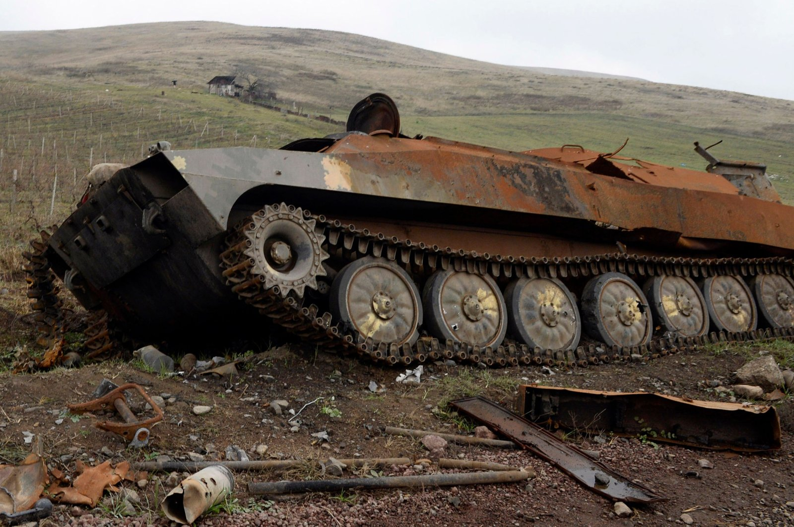 A destroyed Armenian military vehicle lays in the countryside outside the towns of Hadrut and Khojavend, Azerbaijan, Nov. 30, 2020. (AFP Photo)
