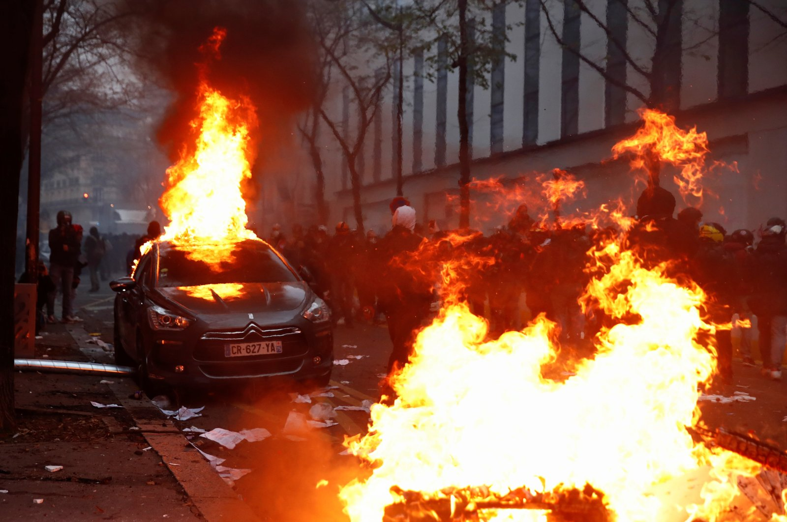 "A car burns during a protest against the ""Global Security Bill,"" Paris, Dec. 5, 2020. (Reuters Photo)"