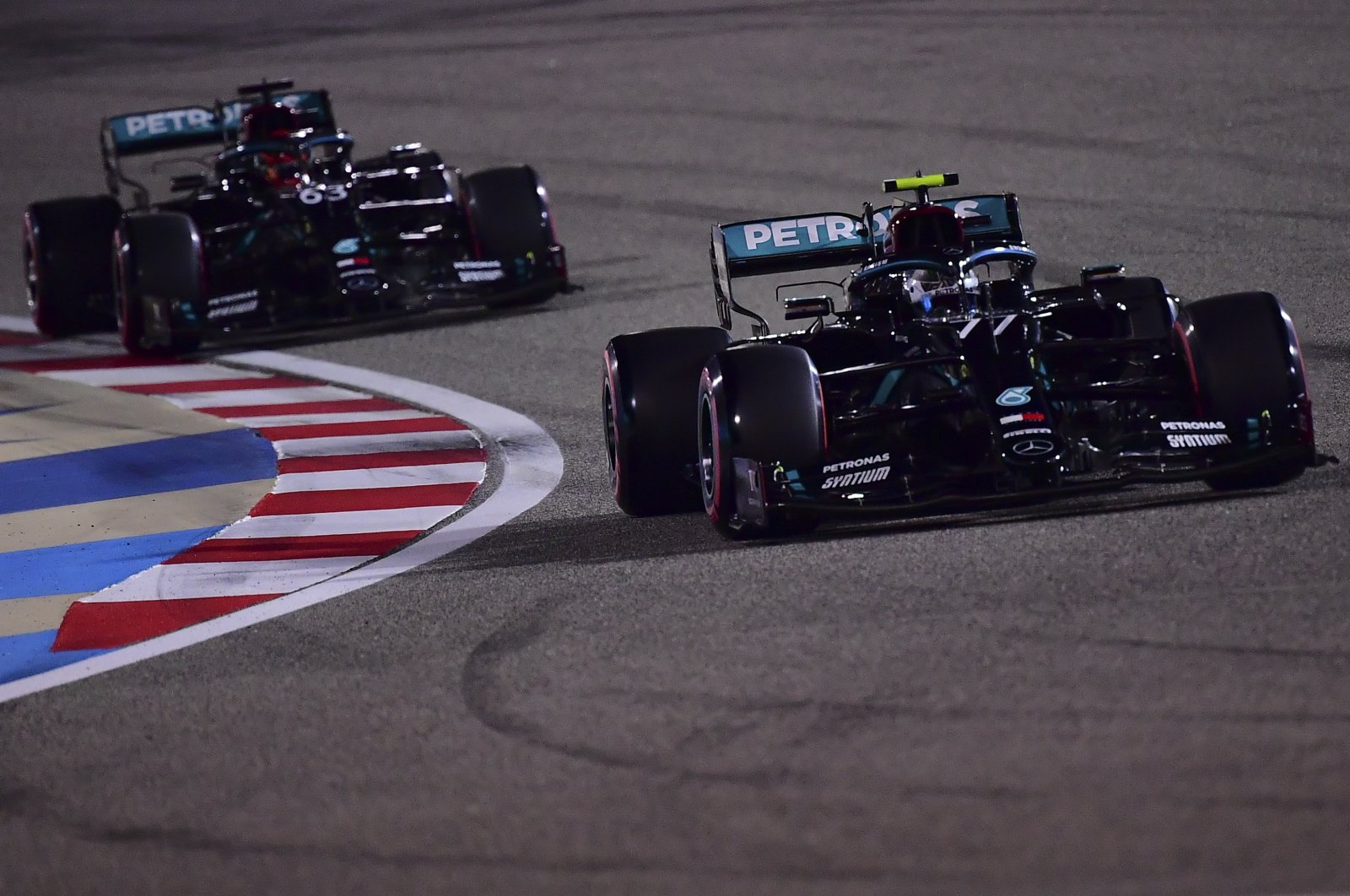 Finnish Formula One driver Valtteri Bottas of Mercedes-AMG Petronas (front) and his British teammate George Russell in action during the qualifying session of the Formula One Sakhir Grand Prix at Bahrain International Circuit near Manama, Bahrain, Dec. 05, 2020 (EPA Photo)