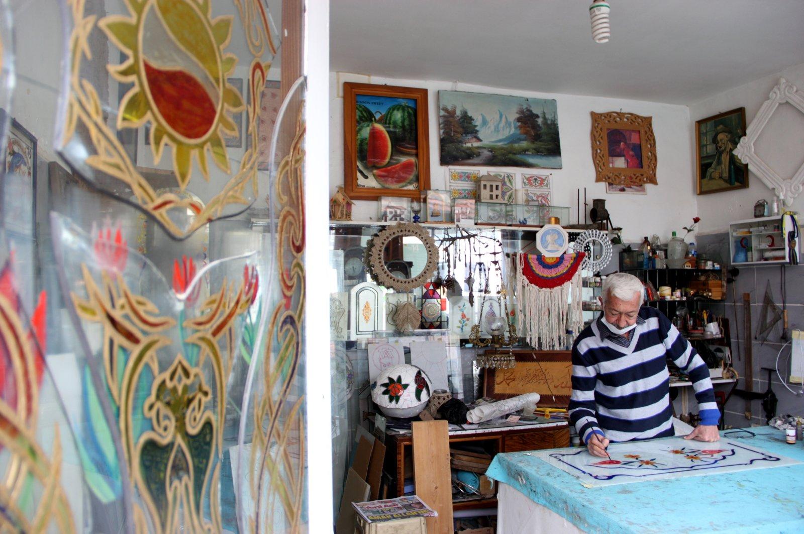 Serdar Arslan with his works in his workshop, Muğla, southwestern Turkey, Dec. 4, 2020. (AA PHOTO)