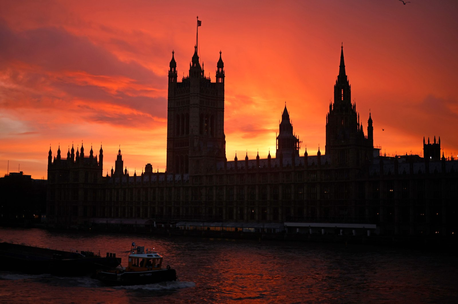 The sun sets behind the Palace of Westminster, the home of the Houses of Parliament, London, Dec. 4, 2020. (AFP Photo)