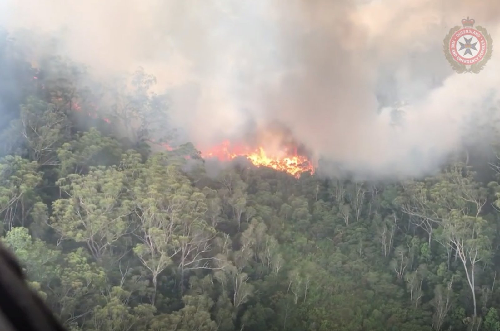 An aerial view shows bushfires on Fraser Island, Queensland, Australia, in this still image taken from video released on December 2, 2020. (Queensland Fire and Emergency Services/via Reuters)