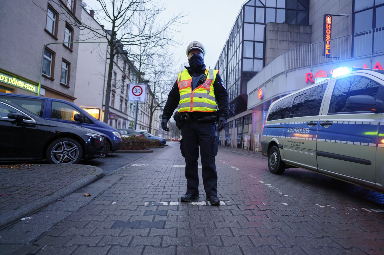 A policeman at the scene after a bomb was found in a residential area in the Gallus district of Frankfurt, Germany, Dec. 6, 2020. (AP Photo)