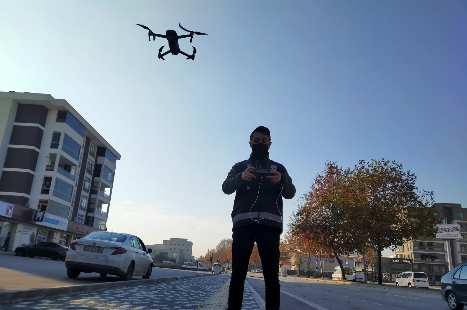 A police officer uses a drone to monitor a weekend curfew in Turkey's Bursa province on Dec. 6, 2020. (DHA Photo)
