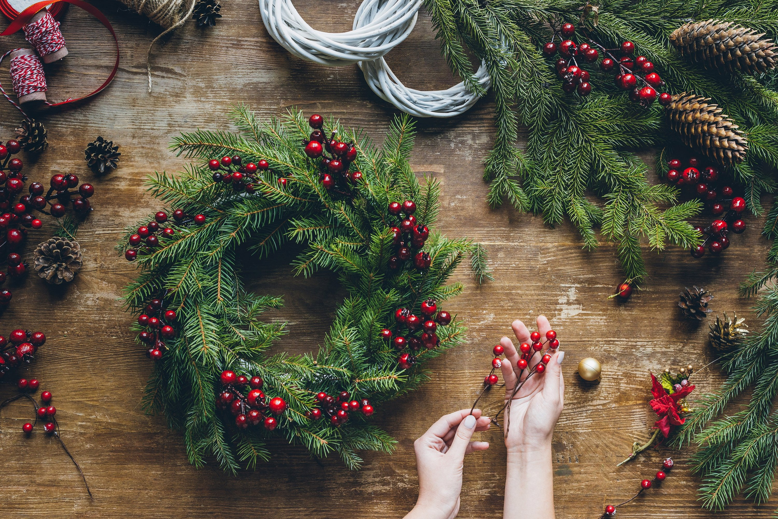 You can find artificial evergreens and holly berries in decoration shops to make your own. (Shutterstock Photo)