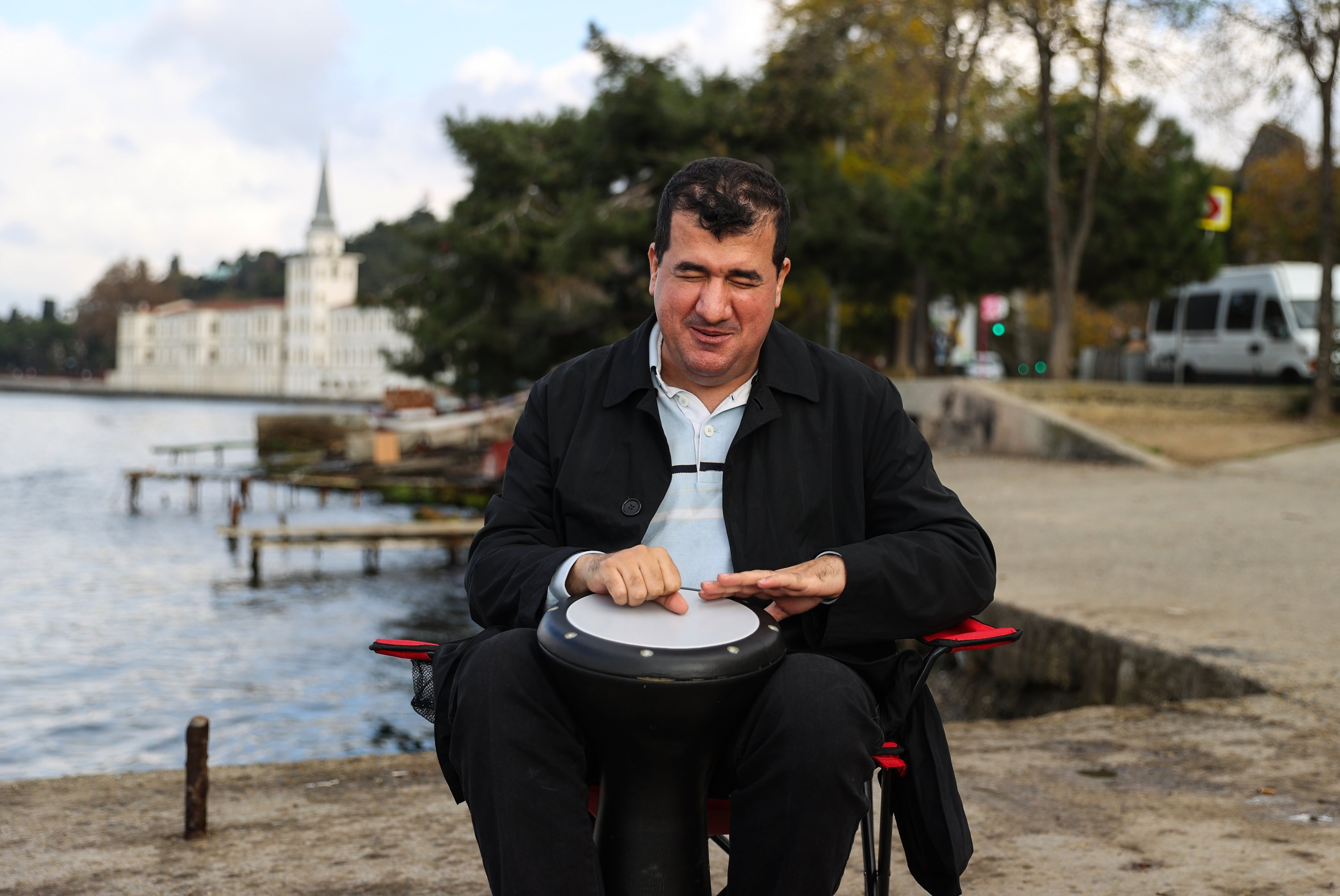 Bilal Göregen plays darbuka in front of the iconic building of the former Kuleli Military High School, Dec. 7, 2020. (AA Photo)