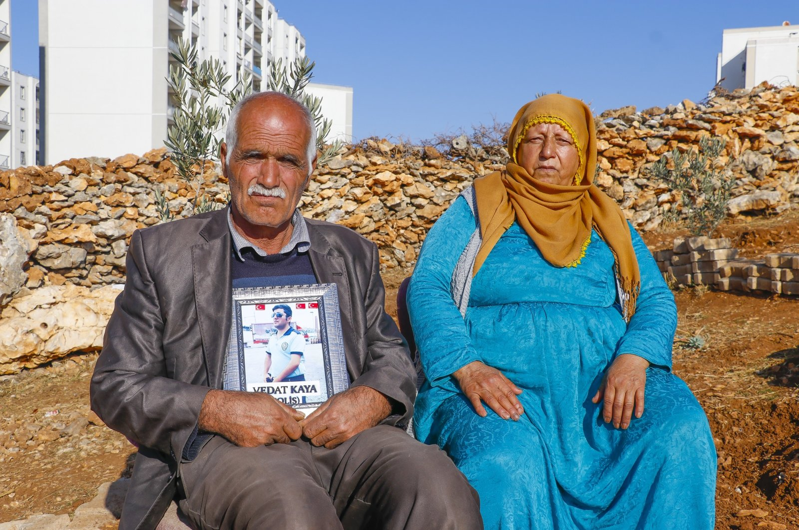 Şeyhmus and Emine Kaya sit, holding a picture of their son Vedat, who was abducted by the PKK five years ago, Dec. 7, 2020. (DHA)