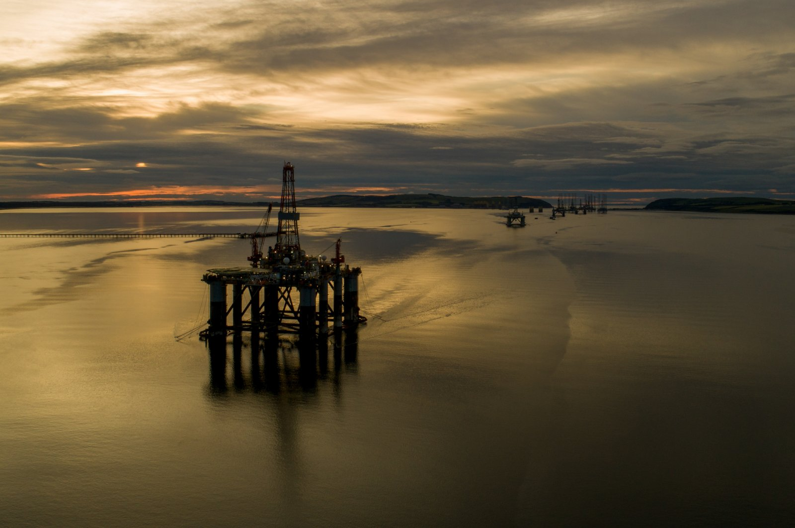 Mobile offshore drilling units stand in the Port of Cromarty Firth in this aerial view in Cromarty, Scotland, June 23, 2020. (Photo by Getty Images)