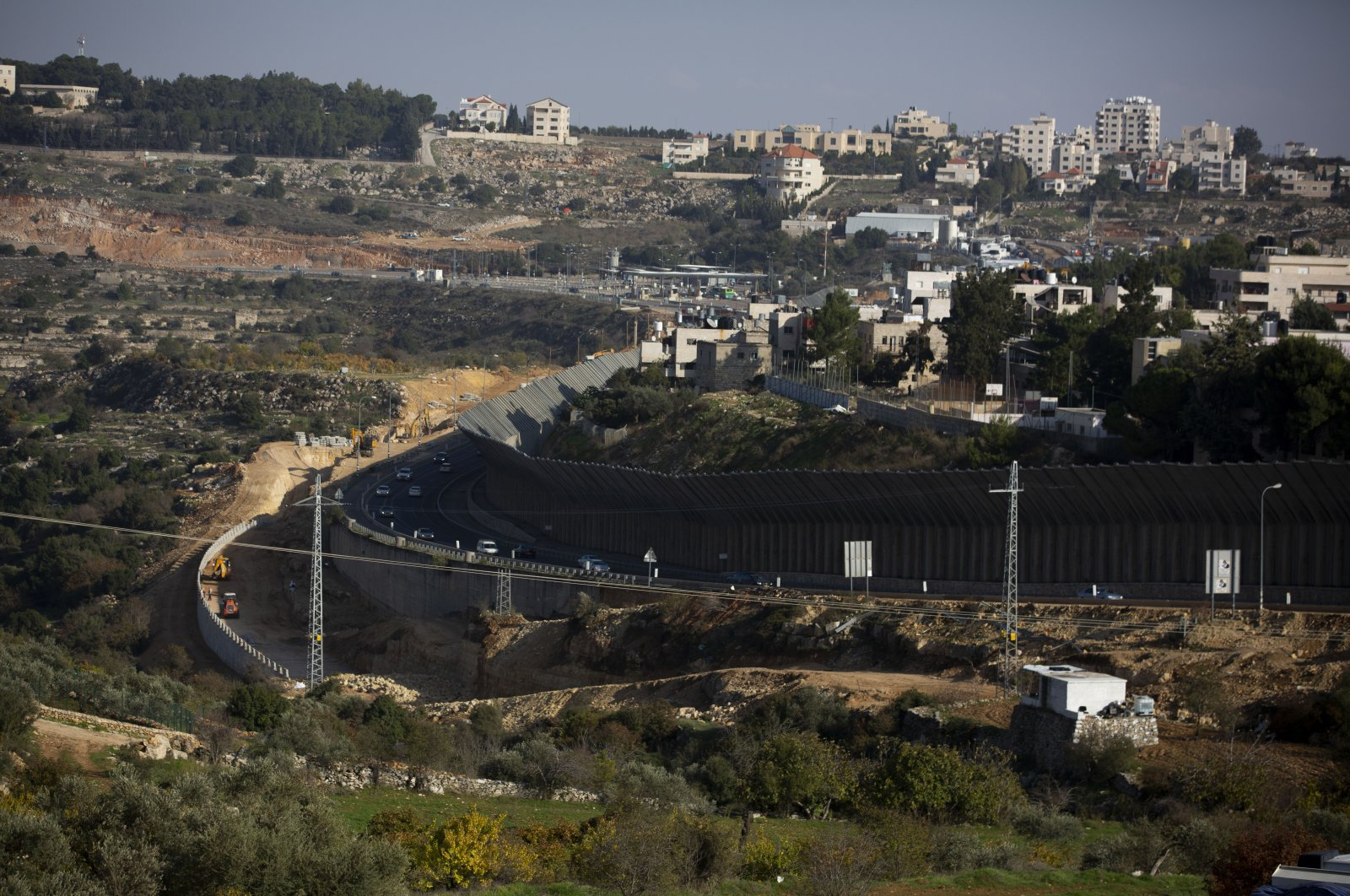 A construction project expands a road to Israeli settlements inside the occupied West Bank, near the city of Bethlehem, Nov. 29, 2020. (AP Photo)