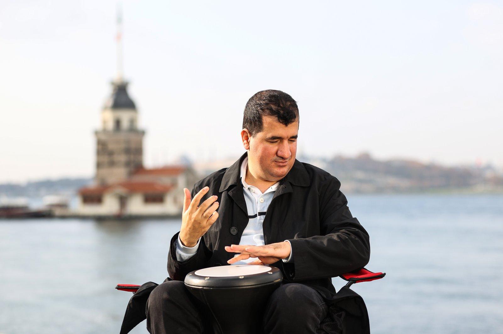 Bilal Göregen plays the darbuka in front of Istanbul's iconic Maiden's Tower, Turkey, Dec. 7, 2020. (AA Photo)
