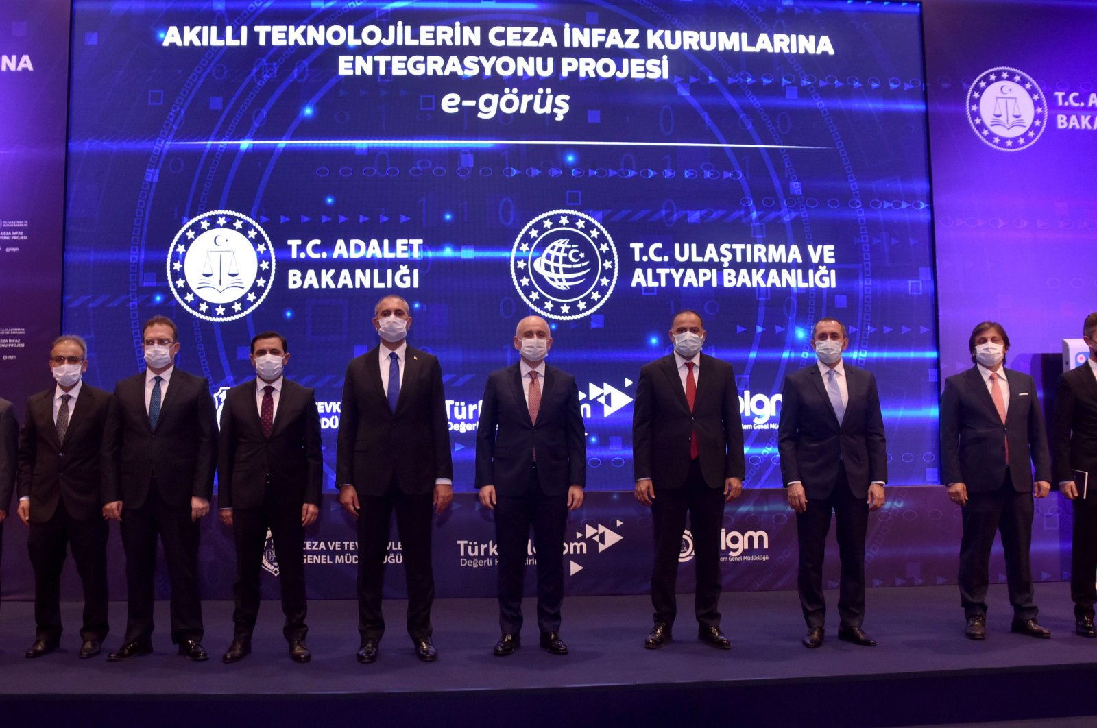 """Justice Minister Abdulhamit Gül (6th from L) and Transport and Infrastructure Minister Adil Karaismailoğlu (6th from R) attend the introductory meeting of the """"Project of Integrating Smart Technologies into Penal Institutions,"""" Ankara, Turkey, Oct. 22, 2020."""