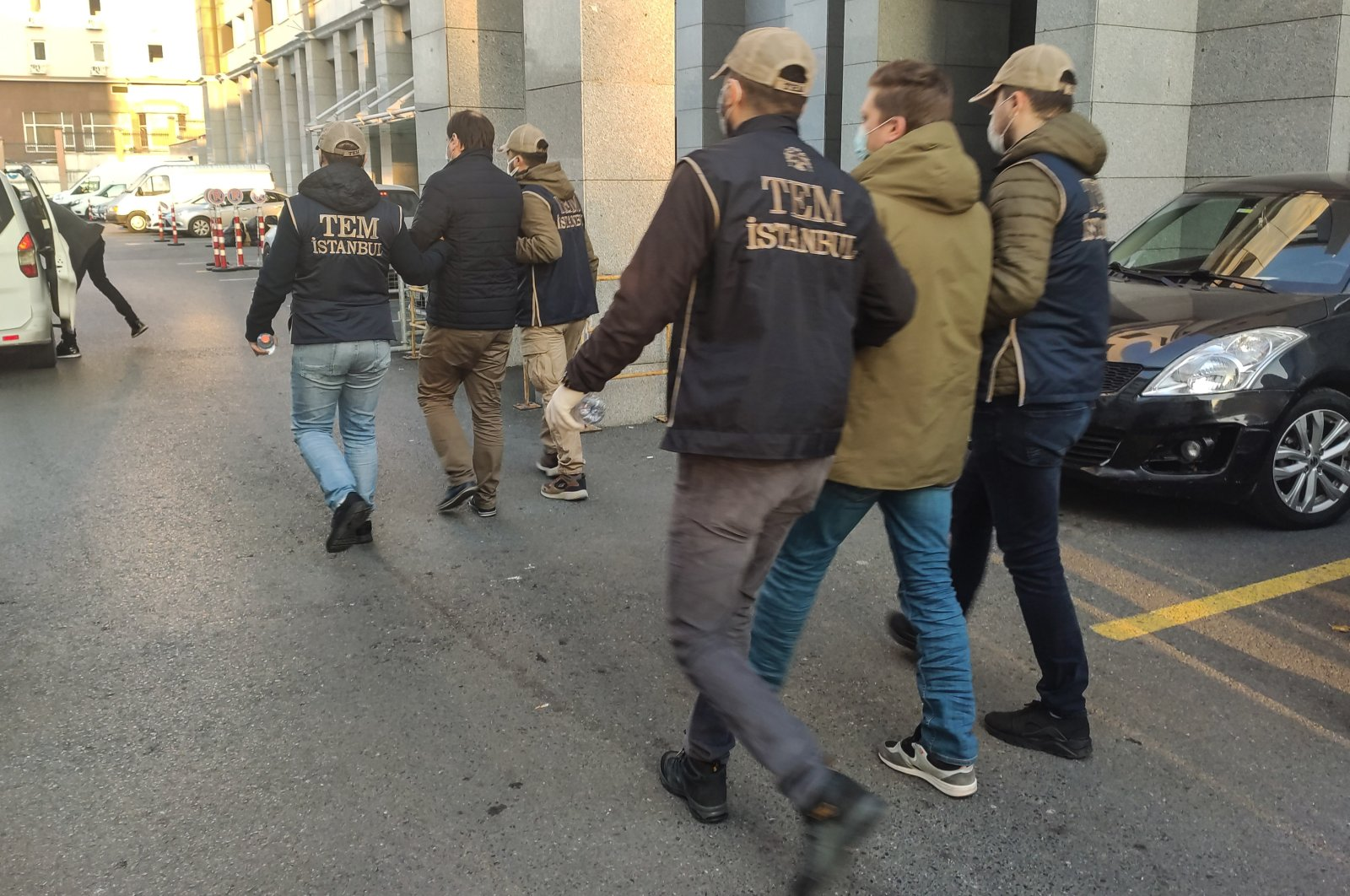 Police escort suspects to the courthouse, in Istanbul, Turkey, Dec. 7, 2020. (DHA PHOTO)