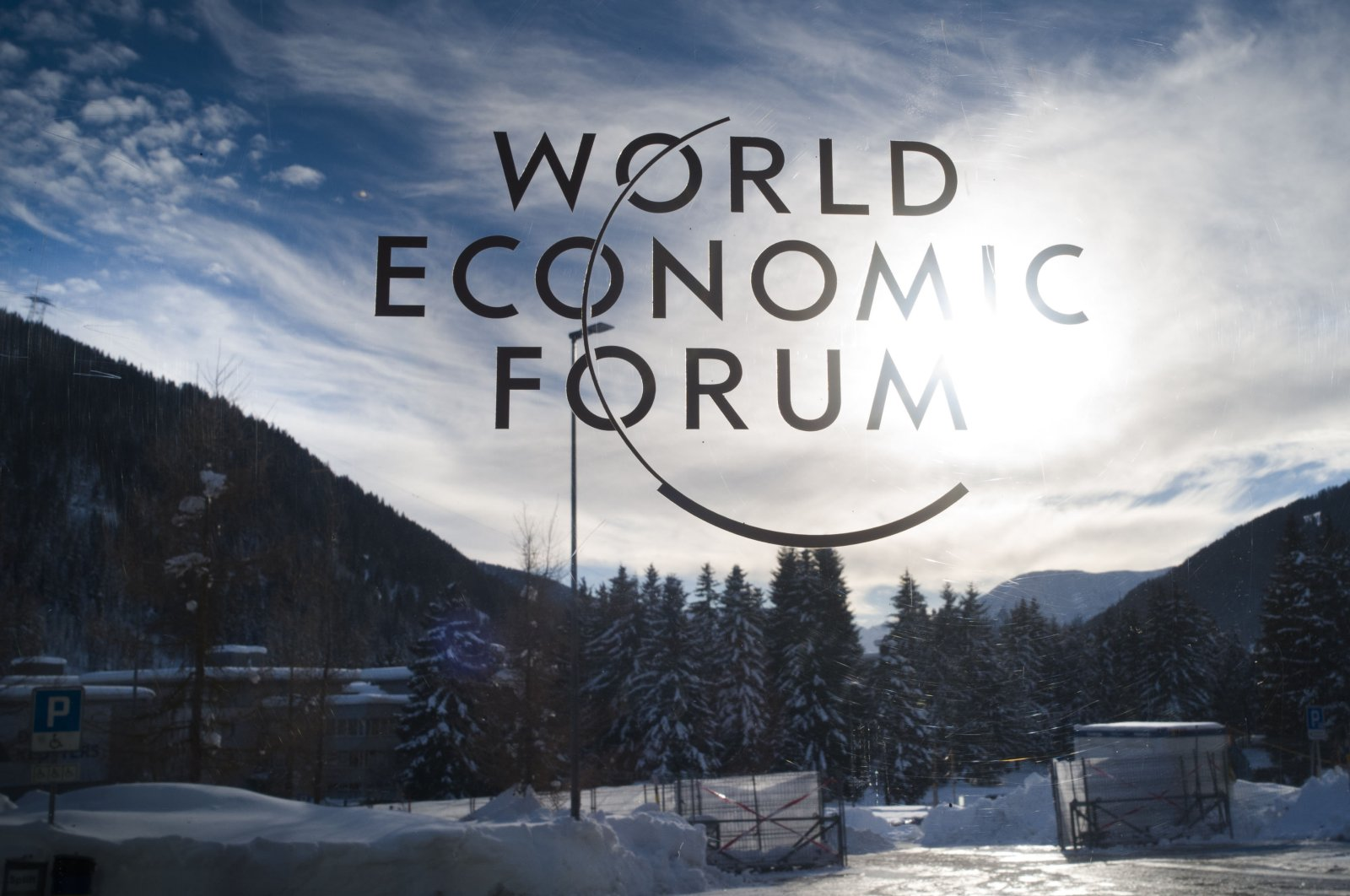 The sign of the World Economic Forum (WEF) is displayed at an entrance door at the congress center on the eve of the meeting in Davos, Switzerland, Jan. 20, 2019. (AP Photo)