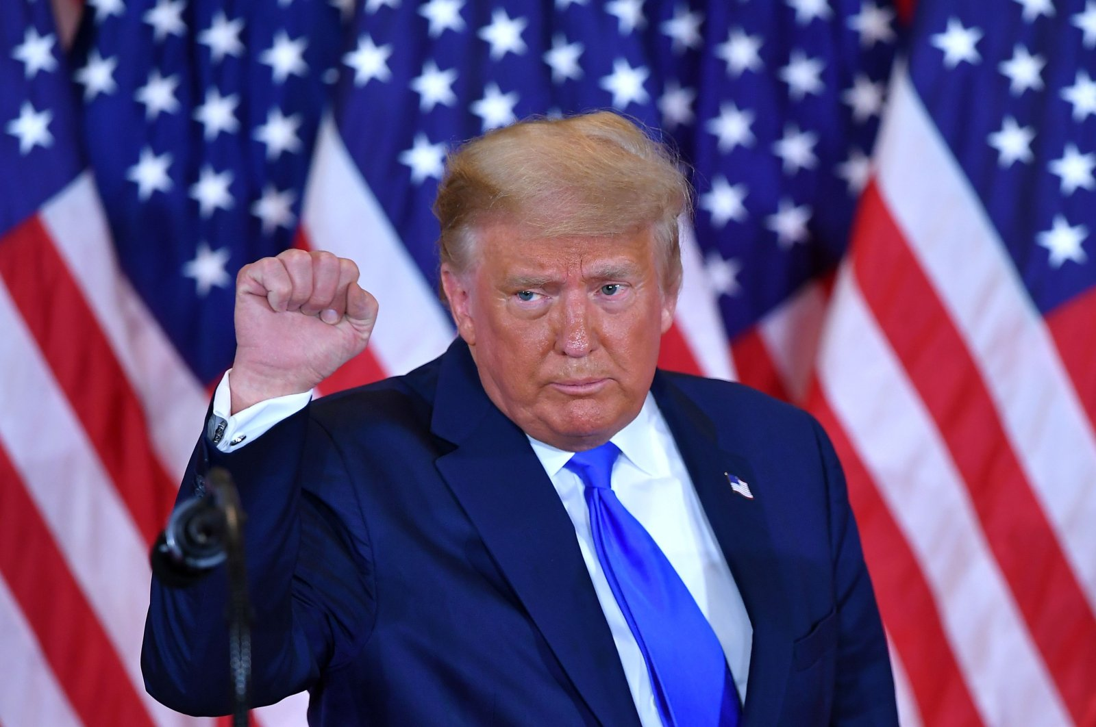 U.S. President Donald Trump pumps his fist after speaking during the election night in the East Room of the White House in Washington, D.C., early on Nov. 4, 2020. (AFP Photo)