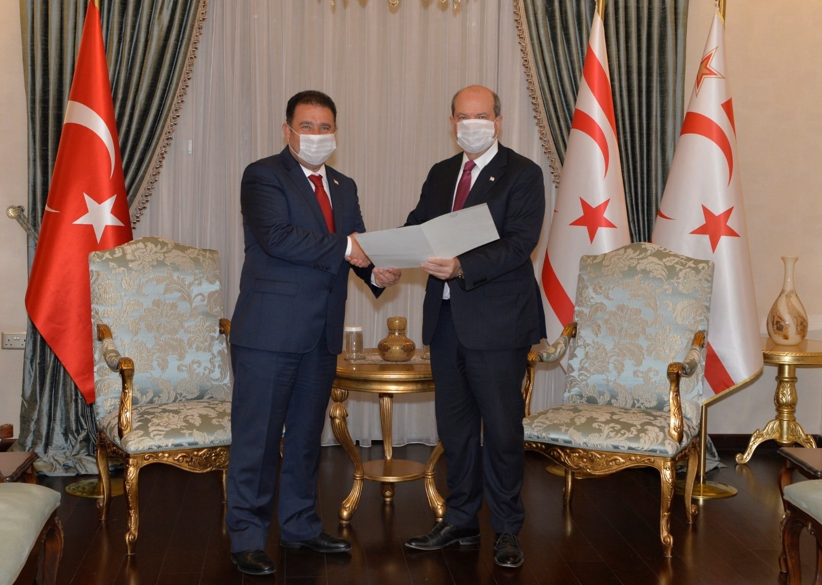 The leader of the Turkish Republic of Northern Cyprus (TRNC) Ersin Tatar (R) assigns the task of forming a new government to the leader of the National Unity Party (UBP) Ersan Saner at the presidency in Lefkoşa (Nicosia), TRNC, Dec. 7, 2020. (AA Photo)