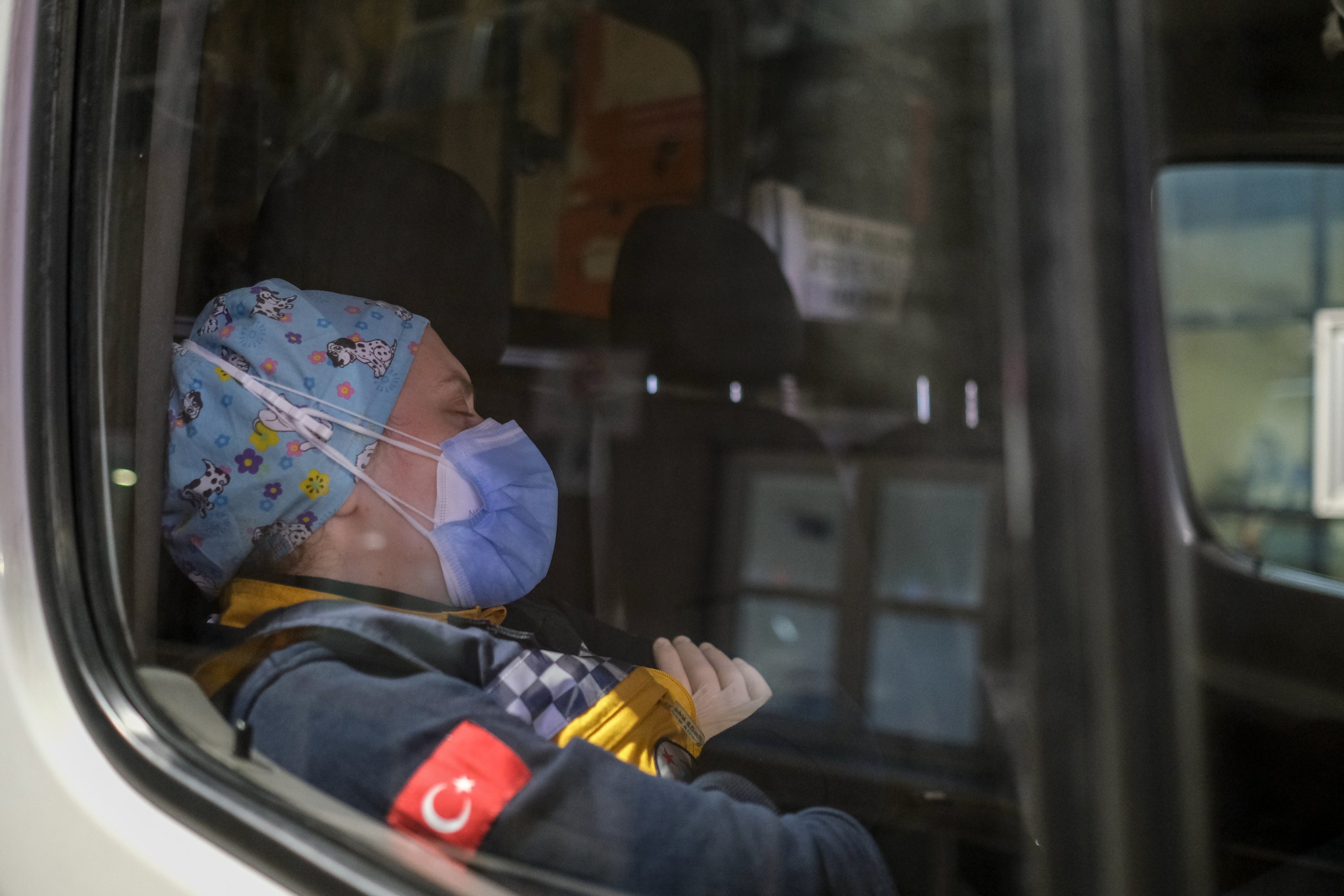 EMT Betül Ocak naps inside the ambulance during a break, in Istanbul, Turkey, Dec. 4, 2020. (PHOTO BY UĞUR YILDIRIM)